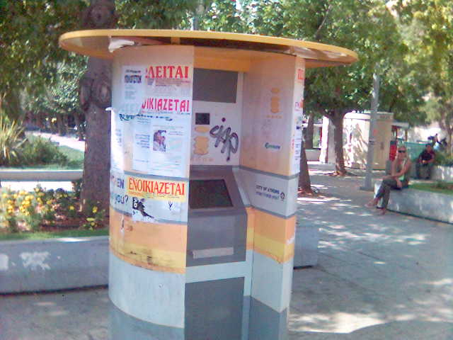 An information kiosk covered with grafiti